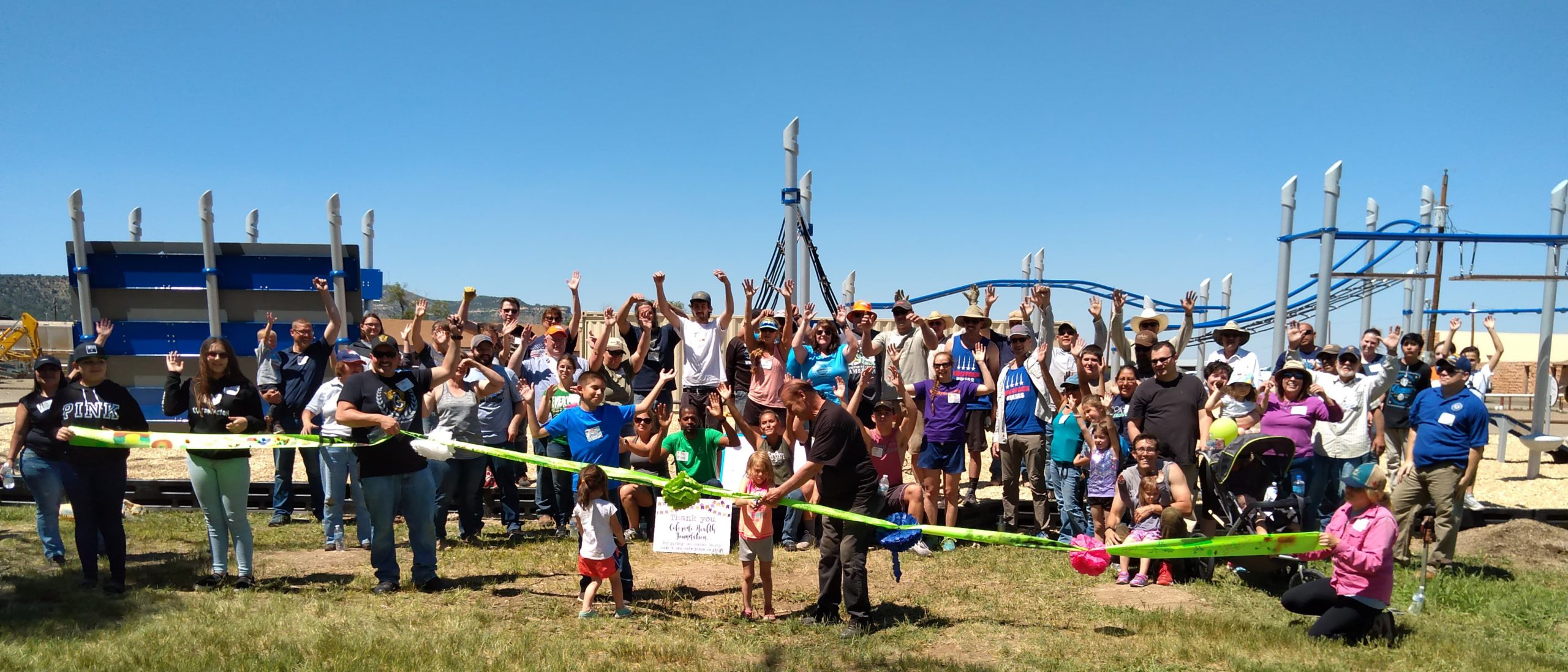 Volunteers celebrate a finished playground in Trinidad, Colorado